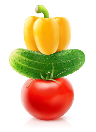 Isolated vegetables. Fresh tomato, cucumber and yellow bell pepper (salad components) on top of each other isolated on white background