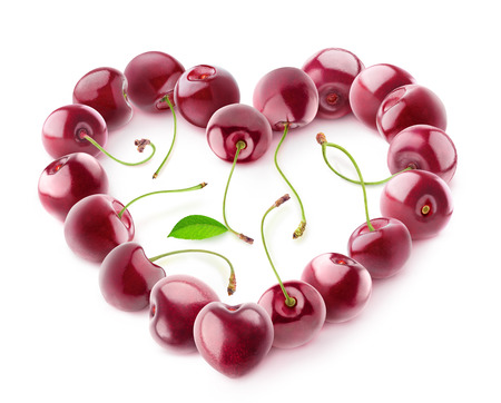 Isolated cherries heart. Sweet cherry berries in shape of a heart isolated on white background 写真素材