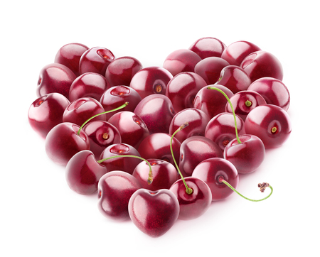 Isolated cherry heart. Heart shape made of cherry fruits isolated on white background