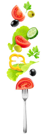 Isolated vegetables mix. Fresh salad components (tomato, cucumber, bell pepper, lettuce and olives) flying over a fork isolated on white background