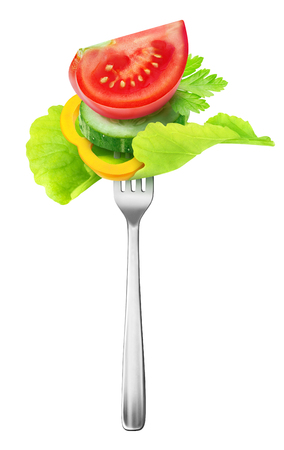 Isolated cut vegetables. Pieces of tomato, cucumber, yellow bell pepper and leaf of lettuce on a steel fork isolated on white background