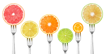 Isolated citrus slices. Pieces of grapefruits, lemon, orange, lime and kumquat on a dessert forks isolated on white background 版權商用圖片