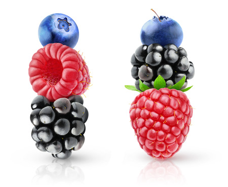 Blackberry, raspberry and blueberry fruits on top of each other isolated on white background
