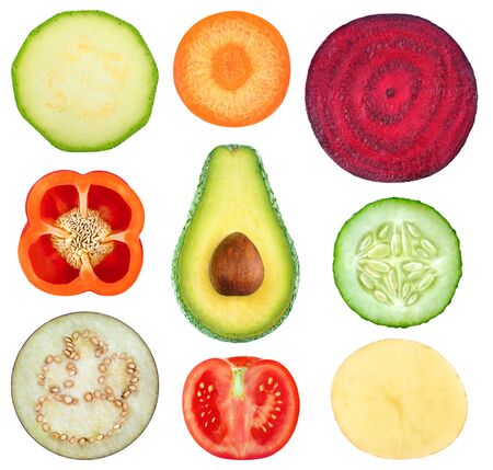 Isolated vegetable slices. Collection of fresh cut vegetables (zucchini, carrot, beetroot, bell pepper, avocado, cucumber, eggplant, tomato, potato) isolated on white background