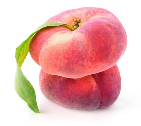 Isolated fruits. Two flat peaches (doughnut peaches) on top of each other isolated on white background 写真素材