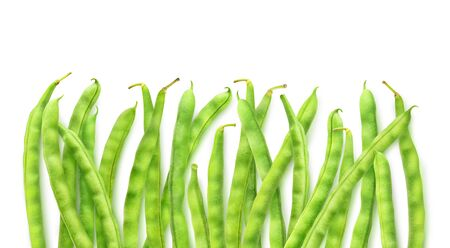 Isolated green beans. Raw runner beans in a row with copy space isolated on white background