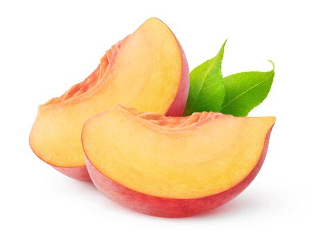Isolated peach pieces. Two slices of peach fruit isolated on white background