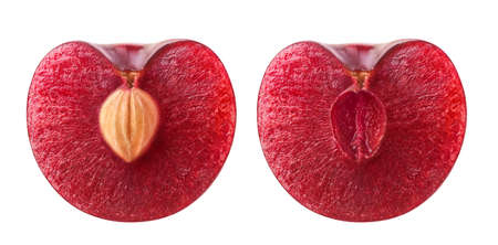 Isolated cherry halves. Fresh sweet cherry fruit cut in half with and without kernel isolated on white background