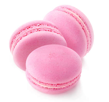 Three pink macaroons (strawberry or raspberry) isolated on white background 写真素材