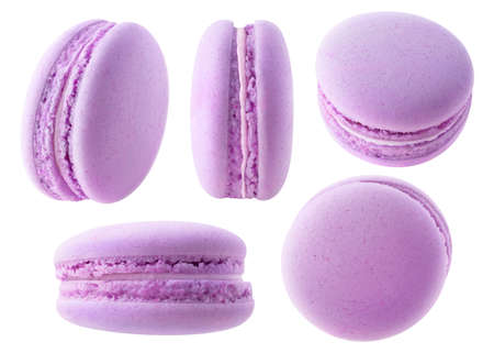 Isolated purple macaroons. Collection of blueberry or blackberry macarons at different angles isolated on white background