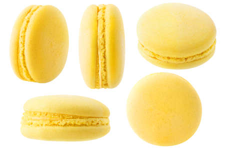 Isolated yellow macarons collection. Lemon macaroon at different angles isolated on white background 写真素材