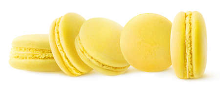 Five yellow (lemon or banana) macaroons in a row isolated on white background