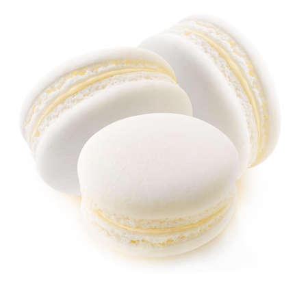 Three white macaroons (vanilla or coconut) isolated on white background
