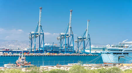 Gantry cranes, container warehouse and ships at cargo terminal of Limassol port, Cyprus Stock fotó