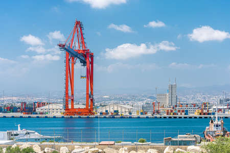 Ship to shore gantry crane and container warehouse in Limassol cargo port, Cyprus