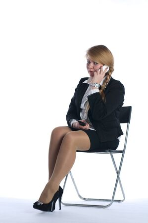 communicates: The businesswoman communicates with colleagues by phone