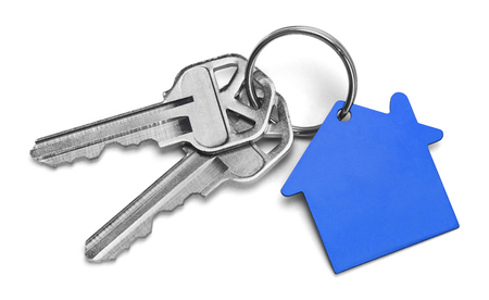 Set of Keys With Blue House Isolated on White Background. Stock Photo