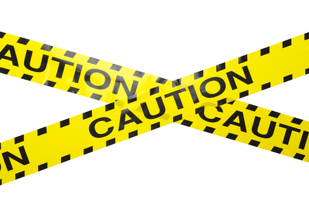 roped off: Yellow Caution Crime Sceen Tape Criss Crossed Isolated on a White Background.