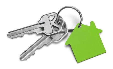 keys isolated: Set of Keys With Green House Isolated on White Background. Stock Photo