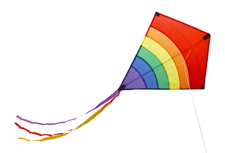 Small Flying Rainbow Kite Isolated on a White Background. Stock Photo