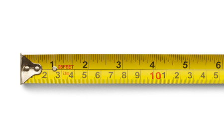 Six Inch Yellow Metal Tape Measure Isolated on a White Background.