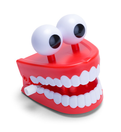 Red Chatter Teeth Isolated on a White Background. Stock Photo