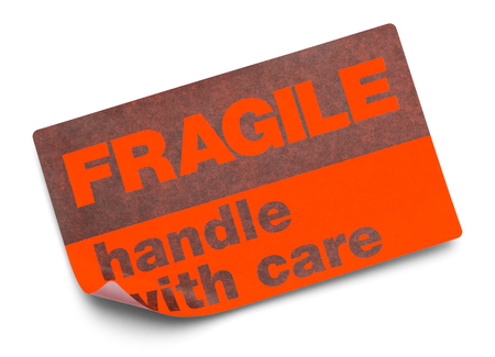 Oranje Breekbaar Stickerhandvat met zorg Geïsoleerd op Witte Achtergrond. Stockfoto