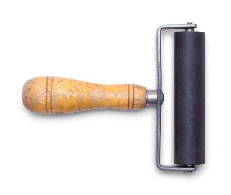 古い木製のハンドル インク ローラーが白い背景で隔離。 写真素材