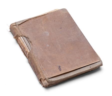 古い身に着け白い背景で隔離の本を閉じられます。
