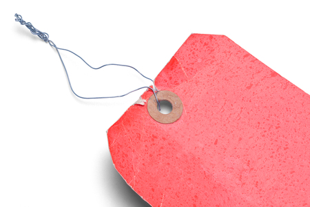 Close Up of Red Old Tag Isolated on White Background. Stock Photo