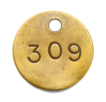 Brass Number Tag Isolated on a White Background.