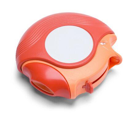 steroid: Round Orange Inhaler Isolated on White Background.