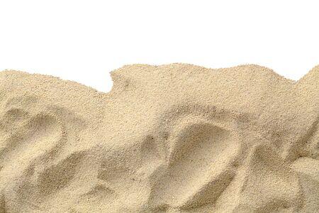 コピー スペースとビーチの砂は、白地をカットしました。 写真素材