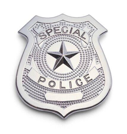 白い背景に分離した銀の警察バッジ。