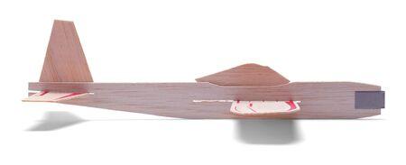 白い背景に分離されたグッズ木製飛行機の側面図です。