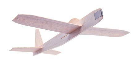 흰 배경에 고립 된 비행 나무 장난감 비행기. 스톡 콘텐츠