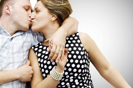 kissing couple celebrates anniversary engagement, still happy and young Stock Photo