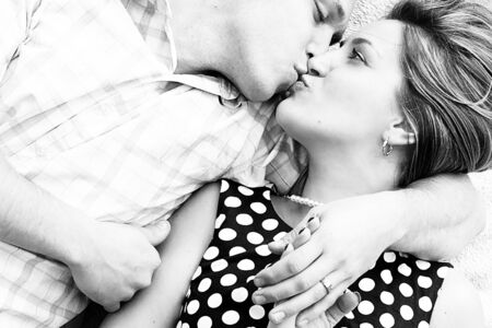 couple kissing and cudling in black and white