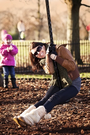 happy girl swinging on the swing in the park Stock Photo - 8671064