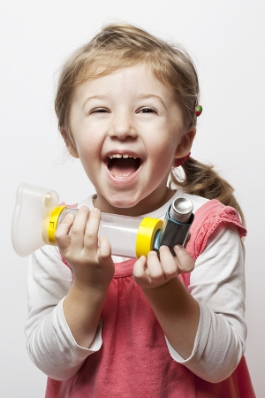 asthma: little girl being happy that she finally is able to breath