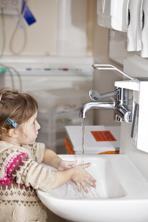 anti bacterial: little girl being very serious about hand hygiene