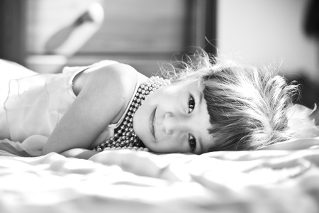 little girl with pearls necklace in sunlight Stock Photo - 9179742