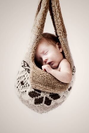 little baby hanging in the winter hat Stock Photo