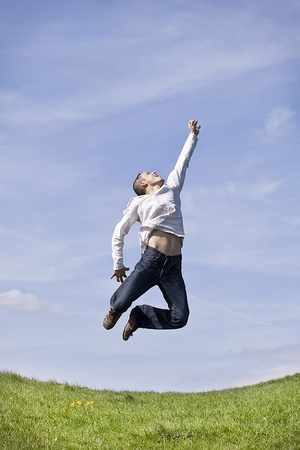 mid life: man jumping up  on the sky background Stock Photo