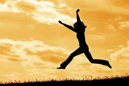 silhouette of jumping  woman on the sky background
