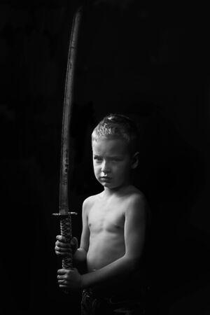 little boy posing with sharp samurai sword Stock Photo - 9576700