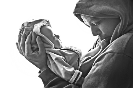 dad and his little baby son in hoodies Stock Photo