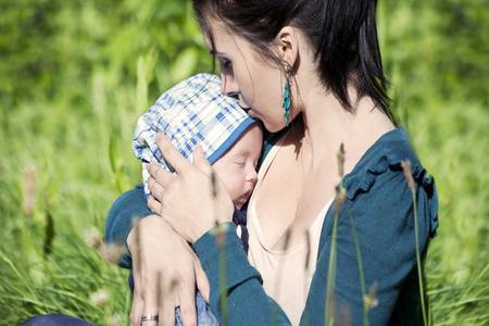 happy and proud mother with her newborn baby Stock Photo - 9774504