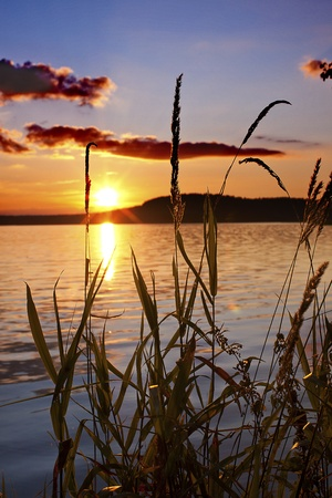 a beautiful and colorful sunset by the lake Stock Photo