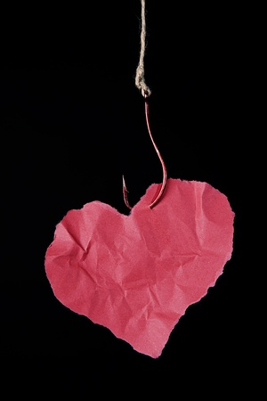damaging: hanging paper heart ilustrating damaging effect of any addiction